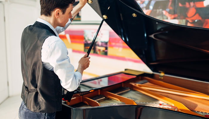 Grand piano with coating