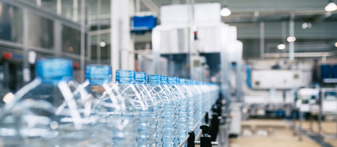 Plastic bottles being manufactured in a factory